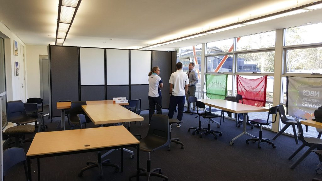 Mobile Whiteboard integrated into a folding classroom divider on wheels.