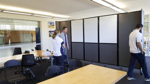 Classroom divider with integrated whiteboards